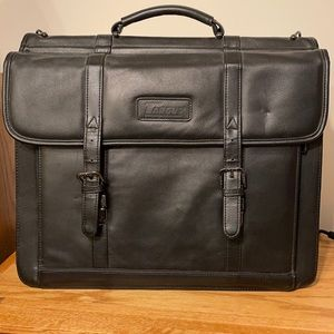 Black leather briefcase. Very functional a lot of compartments
